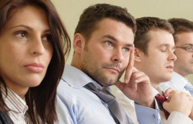 Group of businessmen in a boring meeting